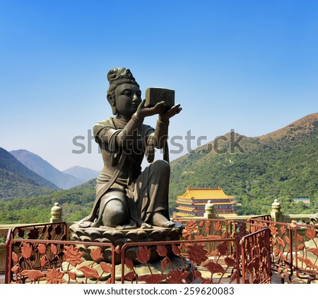 One of Buddhist statues praising and making offerings to the Tian Tan Buddha. The Po Lin Monastery in the background at Lantau Island, in Hong Kong. Hong Kong is popular tourist destination of Asia. - stock photo