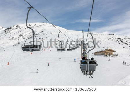 One of chair lifts in a ski resort of a valley of Zillertal - Mayrhofen, Austria - stock photo