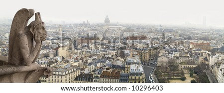 One of chimeras on Notre-Dame and view of Paris, January 2008 - stock photo