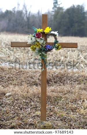 One of many road side memorials to a lost loved one due to an accident on that particular stretch of rural road. - stock photo