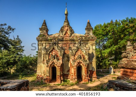 One of many ruined temples in the ancient city and former 14th to 19th century capital of Ava, also called Inwa, located in Mandalay Region, Myanmar - stock photo