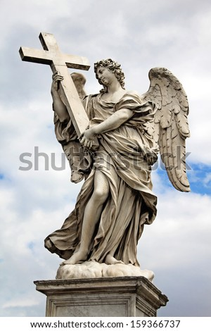 One of the angels (with cross) at the famous Sant' Angelo bridge in Rome, Italy - stock photo
