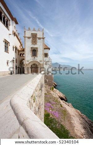 One of the buildings of the Maricel museum and the coast of Sitges on a sunny day. - stock photo