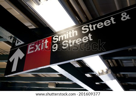 One of the Exit sign in subway station at New York City - stock photo