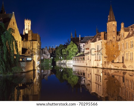 One of the main canals at night with nice reflections from the water. The landmark carillon, or belltower, at Market Square is visible in the upper left. - stock photo