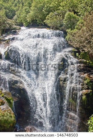 One of the many bautiful waterfalls on the trail Mildford Track - stock photo