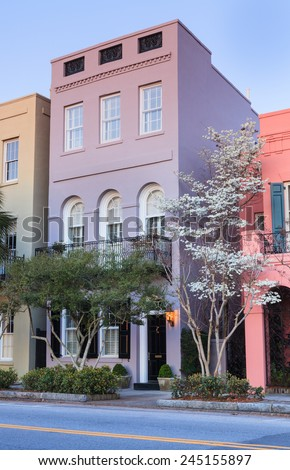 One of the many colorful landmark buildings on the main street in Charleston, South Carolina. - stock photo