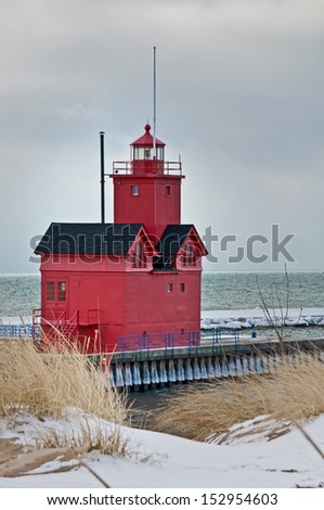 """One of the most recognizable Lake Michigan lighthouses, """"Big Red,"""" is located in Holland MI. - stock photo"""