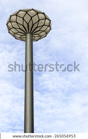 One of the ornate street lamps in the swedish town of Hoganas. - stock photo