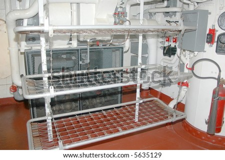 One of the sleeping areas for the sailors on a WWII battleship. - stock photo
