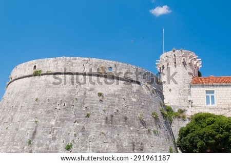 One of the towers in the ancient town wall of Korcula in Croatia - stock photo