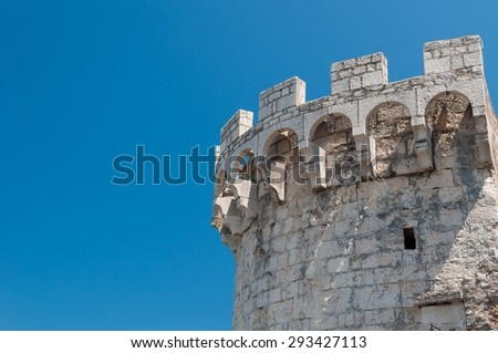 One of the towers in the ancient town wall of Korcula in Croatia. Blue sky in background - stock photo
