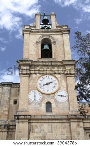 one of the two bell towers of st.john's co-cathedral in valletta, malta - stock photo