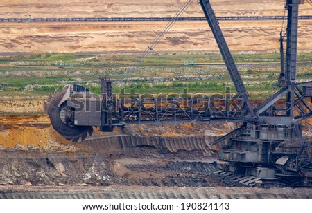 One of the world's largest excavators digging lignite (brown-coal) in one of the world's largest open-cast mines  - stock photo