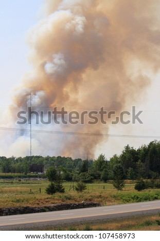 One of two forest fires burning on July 12, 2012 within the city of Ottawa, Ontario. Much of this part of Canada has experienced one of the hottest and driest years on record. - stock photo