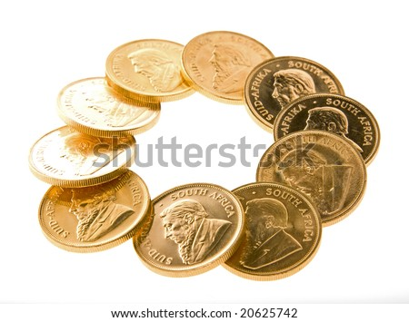 One Ounce gold Krugerrand coins from South Africa isolated on white and arranged in a ring. - stock photo