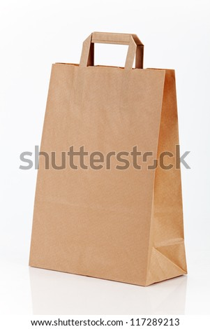 One paper shopping bag on white - stock photo