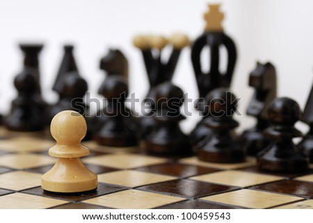 One pawn standing up to a stronger opponent. - stock photo