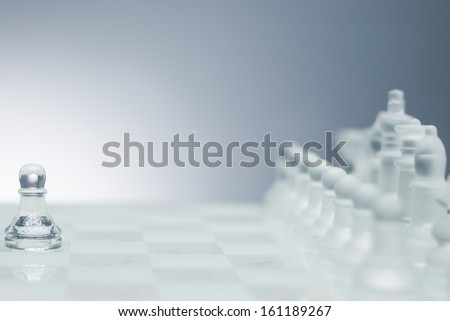 One pawn staying against full set of chess pieces. - stock photo