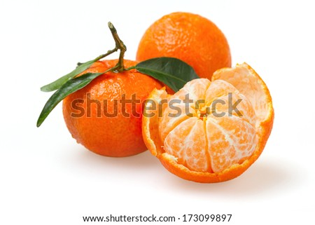One peeled tangerine and two with a peel on a white background - stock photo