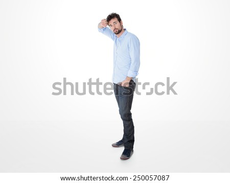 one pensive man holding his front with his hand - stock photo
