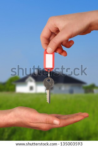 One person giving to other key for new house - stock photo