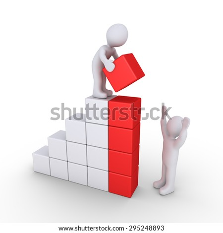 One person is putting the last block of the chart and the other is giving instructions - stock photo
