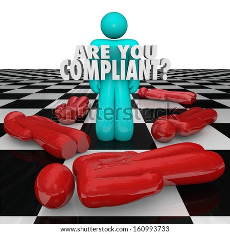 One person stands successful with words Are You Compliant to illustrate following important legal rules, regulations and guidelines - stock photo