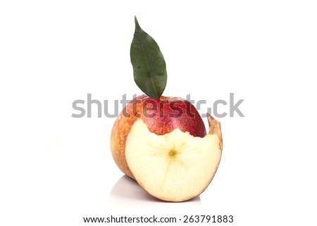 one piece bitten off juicy apple with a slice - stock photo