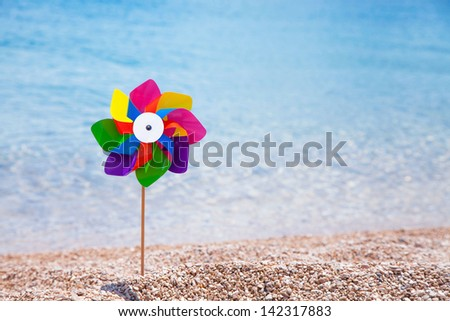 One pinwheels at the beach - stock photo