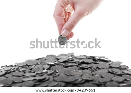 One polish zloty coins in human hand. Savings and business concept isolated on white background. - stock photo