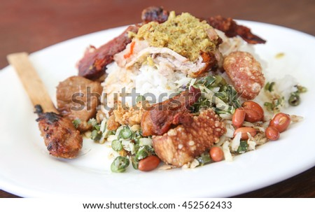 One portion of roasted pig with rice -  one of Baliâ??s most famed dishes. - stock photo