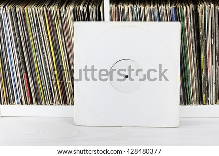 One record near stack of old collection of vinyl discs. closeup - stock photo