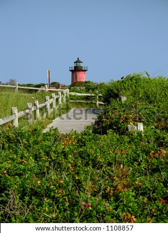one red lighthouse - stock photo