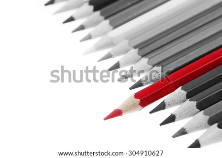 One red pencil standing out from others - stock photo