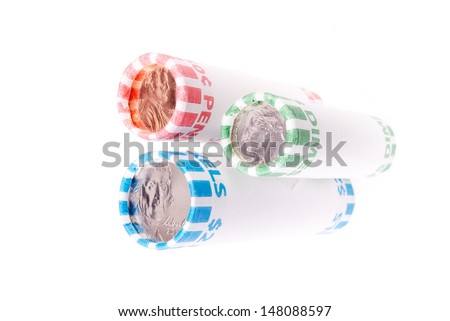 One Roll Each of Pennies Nickels and Dimes - stock photo