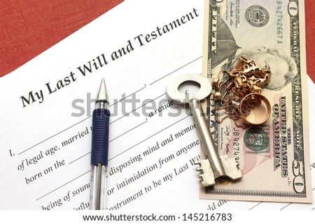 one's last will and testament with gold and money, close-up - stock photo
