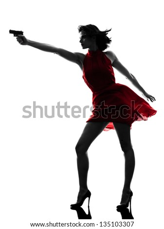 one sexy caucasian woman holding gun in silhouette studio isolated on white background - stock photo