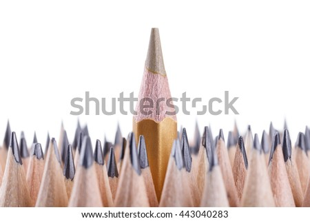 One sharpened gold pencil among many ones - stock photo