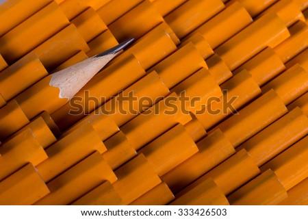 One sharpened pencil among many not sharp - stock photo