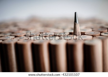 One sharpened pencil standing out from the other blunt pencil - stock photo