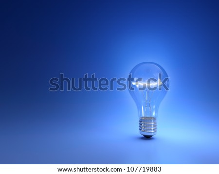 One simple glowing light bulb isolated on blue background - stock photo