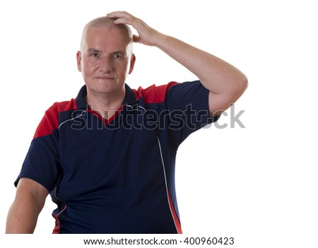 One sitting mature man wearing blue and red shirt with blank stare scratching his head over white background - stock photo
