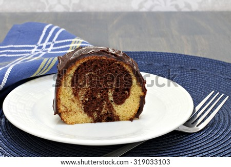 One slice of fresh baked, frosted marble cake of chocolate and vanilla. - stock photo