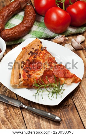 One slice of pizza with toppings. - stock photo