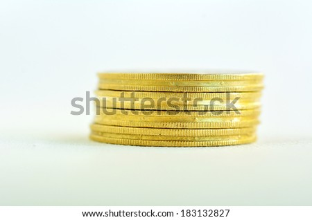 One small Golden gold coins stack isolated on white background. Concept photo of bank, money, banking, finance, economy,  saving and loans (Isolated on white background) - stock photo