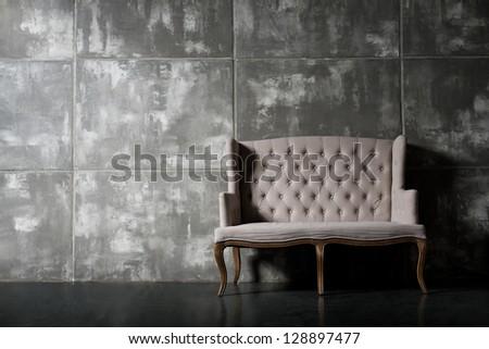 one soft chair on dark grey background,  horizontal photo - stock photo