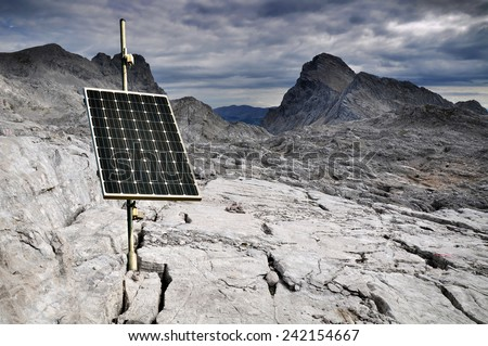 One solar panel in mountains. - stock photo