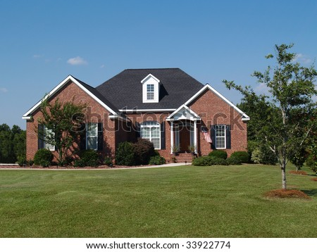One story brick residential home. - stock photo