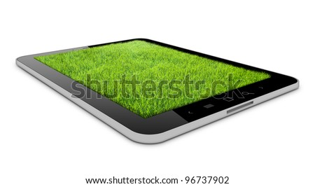 one tablet on the white backgrounds with grass field on it - stock photo